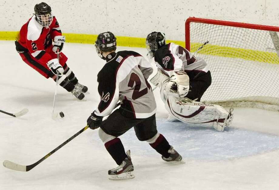 """SPORTS--Fairfielfd Ward/Ludlow  VS. Milford Hockey--Farfield/Ludlow's Conor Sharlop scores during 2nd period action. With Milford goalie John DePlams is teammateJarrod <a href=""""http://Butts.at"""">Butts.at</a> net is  Photos by  Melanie Stengel"""