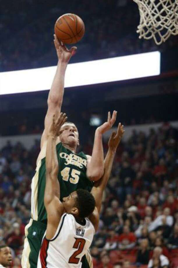 Colorado State's Colton Iverson shoots over UNLV's Khem Birch during the first half of an NCAA basketball game, Feb. 20, 2013, in Las Vegas. Photo: AP / FR159466 AP