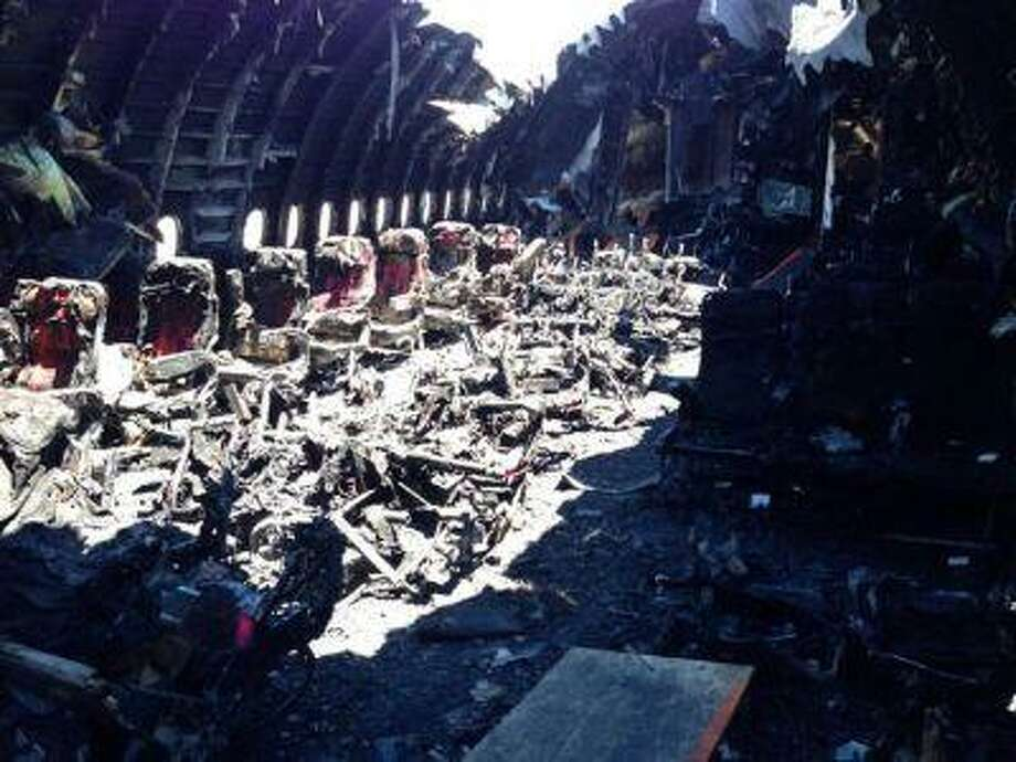 The charred interior cabin of Asiana Airlines Flight 214 is pictured after its crash landing on Saturday in San Francisco, California, in this undated National Transportation Safety Board (NTSB) handout photo. Photo: REUTERS / X80001