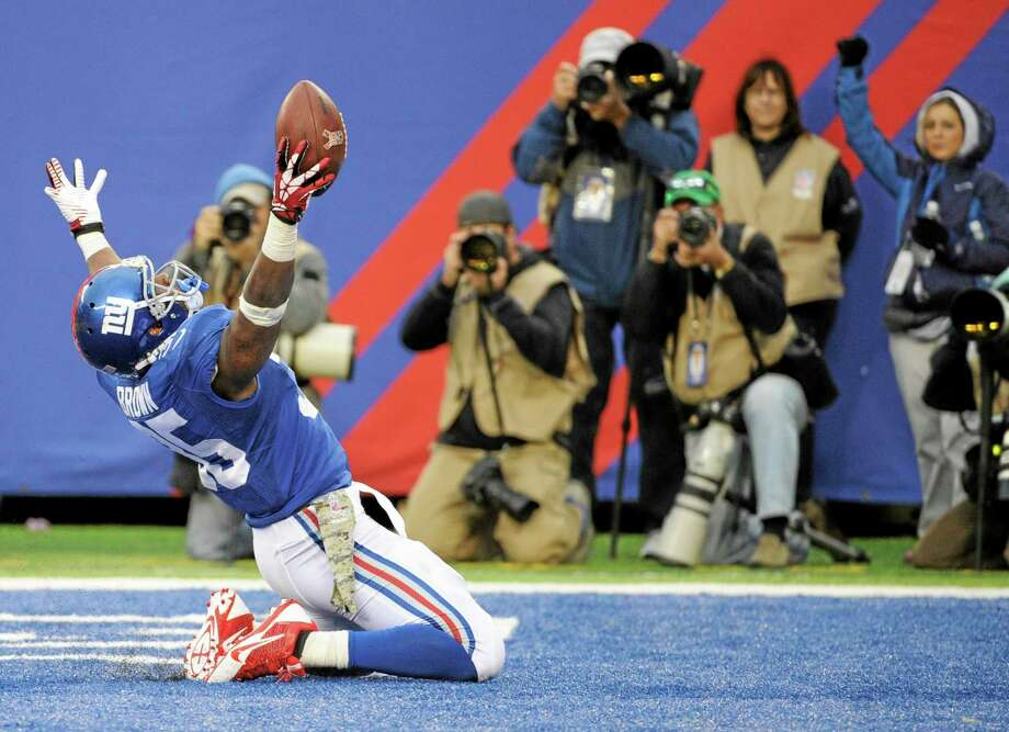 Giants running back Andre Brown celebrates after scoring a touchdown against the Raiders during the second half on Sunday. Photo: Bill Kostroun — The Associated Press   / FR51951 AP