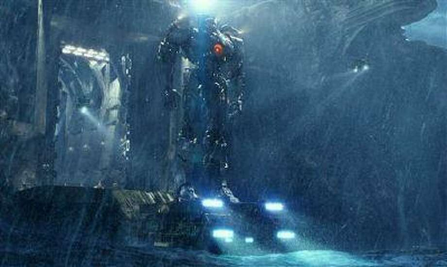 """This film publicity image released by Warner Bros. Pictures shows the Gipsy Danger robot in a scene from """"Pacific Rim."""" (AP Photo/Warner Bros. Pictures) Photo: AP / Warner Bros. Pictures"""