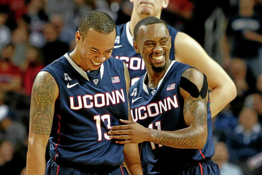 UConn's Shabazz Napier (13) and Ryan Boatright (11) smile during a break in the second half of Friday's game against Maryland. Photo: Jason DeCrow — The Associated Press   / FR103966 AP
