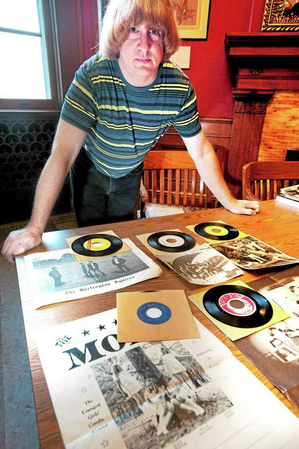 "vmWilliams - New Haven RegisterMike Markesich, author of ""Teen Beat Mayhem"" poses with part of his 60's garage band memorabilia collection at the Blackstone Library in Branford November, 8. Photo: Journal Register Co."