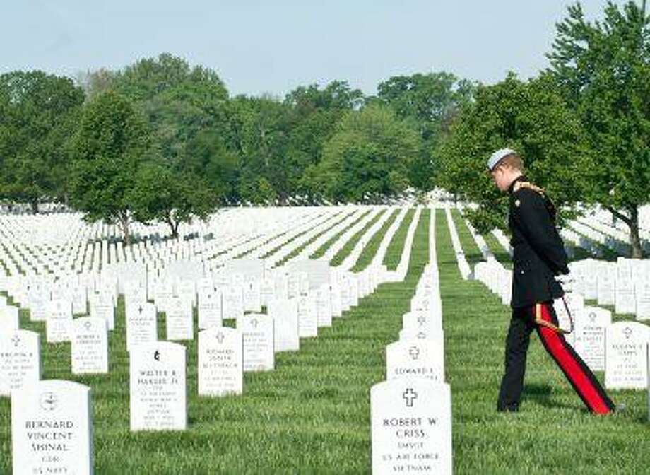 Prince Harry of Britain visits Section 60 of Arlington National Cemetery, where veterans of the wars in Iraq and Afghanistan are buried, in Virginia on May 10, 2013. Photo: ASSOCIATED PRESS / AP2013