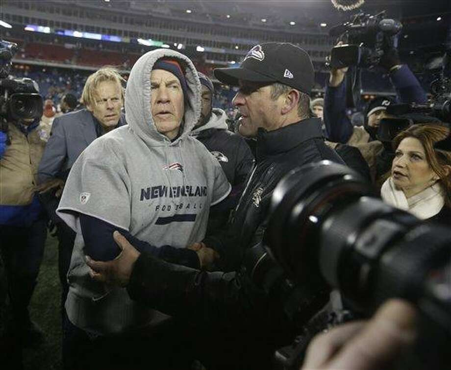 New England Patriots head coach Bill Belichick, left, and Baltimore Ravens head coach John Harbaugh, right, meet at midfield after the NFL football AFC Championship football game in Foxborough, Mass., Sunday, Jan. 20, 2013.  The Ravens won 28-13 to advance to Super Bowl XLVII. (AP Photo/Elise Amendola) Photo: ASSOCIATED PRESS / AP2013