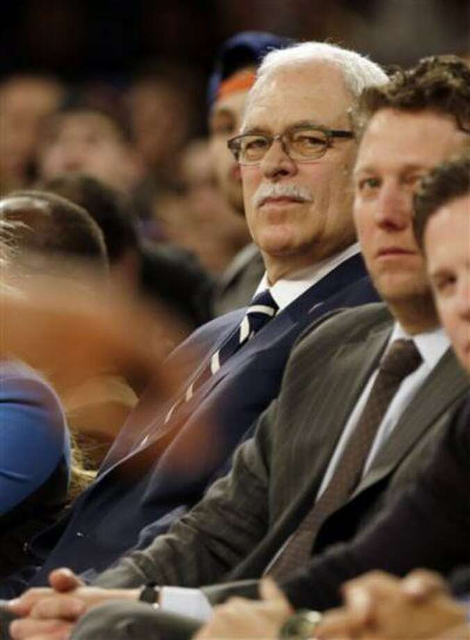 Former NBA coach Phil Jackson watches the first half of a basketball game between the New York Knicks and the Milwaukee Bucks, April 5, 2013, in New York. Photo: AP / AP