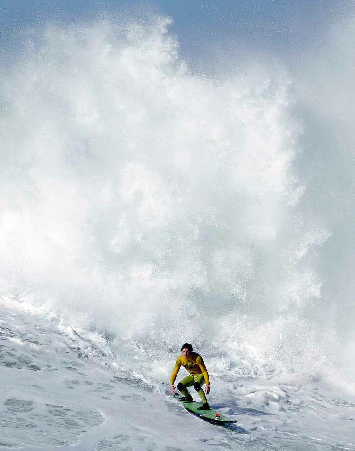 Colin Dwyer competes during heat 4 of the Mavericks Invitational big wave surf contest in Half Moon Bay, Calif., Sunday, Jan. 20, 2013. (AP Photo/Marcio Jose Sanchez) Photo: ASSOCIATED PRESS / AP2013