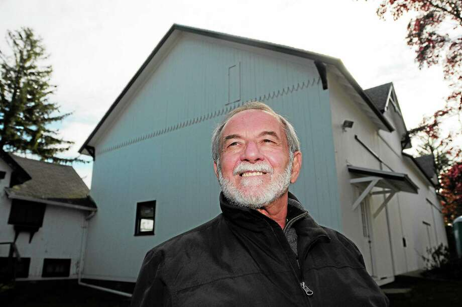 (Peter Hvizdak — Register)Joe Garbus, an activist for the Walnut Beach area of Milford, stands by the Stowe Farm Barn at 66 Stowe Avenue in Milford Tuesday November 5, 2013. Garbus and others have been working to get the city-owned property to be used as an arts barn. Photo: New Haven Register / ©Peter Hvizdak /  New Haven Register