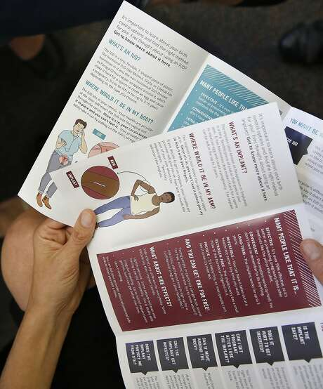 Dehlendorf displays materials aimed at reducing teenage pregnancies. The teen birth rate has fallen significantly. Photo: Liz Hafalia, The Chronicle