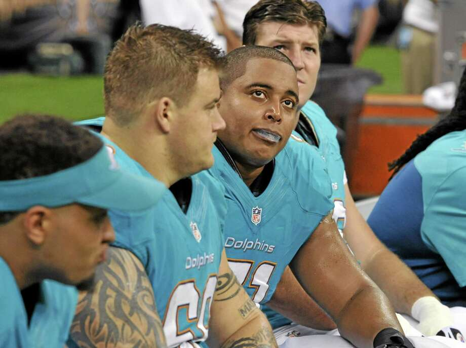Right or wrong, Register sports columnist Chip Malafronte feels the locker room culture in football may never change, even after the events in Miami involving Dolphins offensive linemen Richie Incognito, center left, and Jonathan Martin, center right. Photo: Bill Feig — The Associated Press   / FR44286 AP