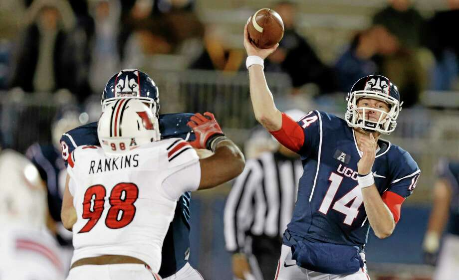 UConn quarterback Tim Boyle passes as he is pressured by Louisville defensive end Sheldon Rankins during the second half of the 20th-ranked Cardinals' 33-10 win on Friday night at Rentschler Field in East Hartford. Photo: Charles Krupa — The Associated Press   / AP