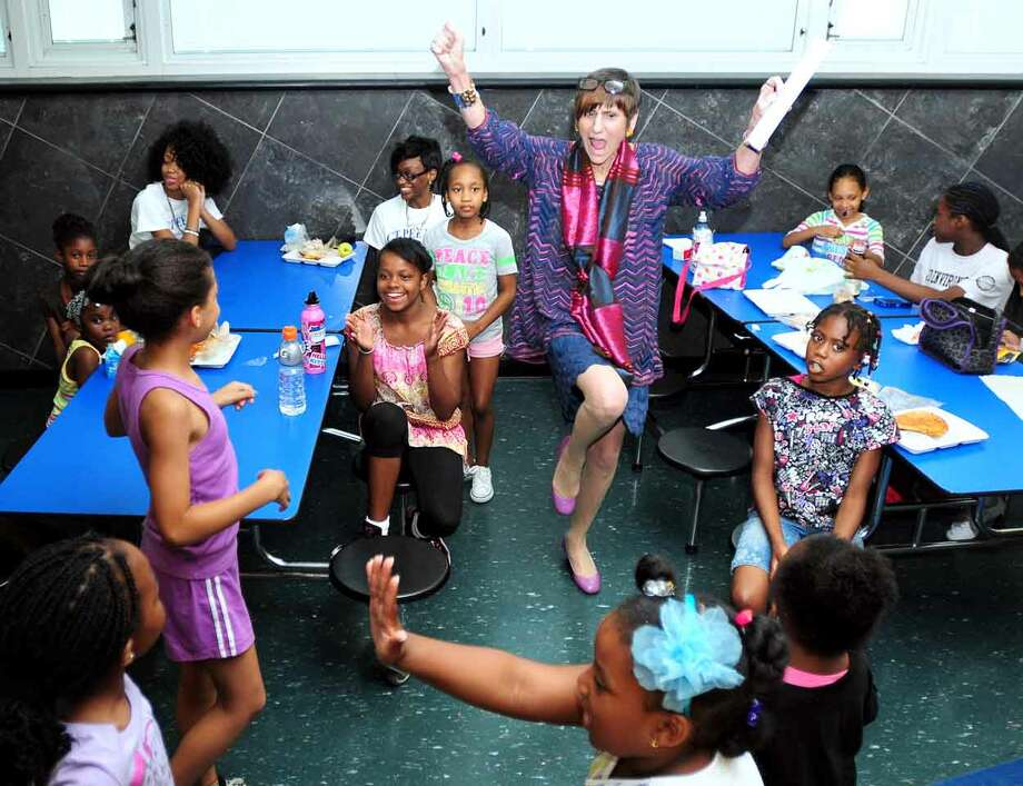 U.S. Rep. Rosa DeLauro (center) does a cheer while talking with students in a cheerleader camp at Hillhouse High School in New Haven on 7/12/2013. Arnold Gold -- Register