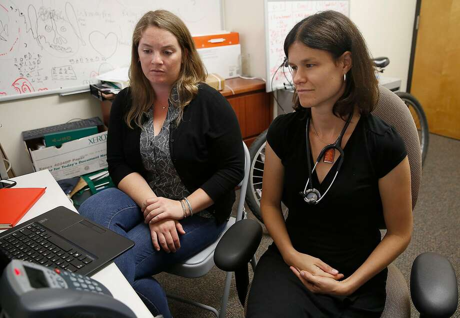 UCSF project manager Reiley Reed (left) and director Dr. Christine Dehlendorf (right)  join a conference call with others effected by the funding cut on Friday, July 21, 2017, in San Francisco, Calif.   The UCSF program will be loosing $2.8 million federal funding of the $213.6 million awarded by the Obama administration to find scientifically valid ways to help teenagers avoid pregnancy. Photo: Liz Hafalia, The Chronicle