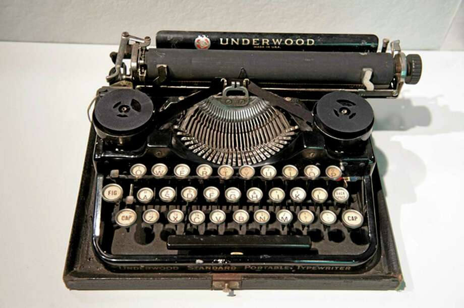 "In this Aug. 22, 2013, photo provided by Northeastern University, Ernest Hemingway's 1929 Underwood Standard typewriter sits on display at in an exhibit called ""Celebrity Type."" Typewriters that belonged to notable 20th century people, including Tennessee Williams, John Lennon, Jack Kevorkian, and ""Unabomber"" Theodore Kaczynski are in the exhibit. (AP Photo/Northeastern University, Brooks Canaday) Photo: AP / Northeastern University"