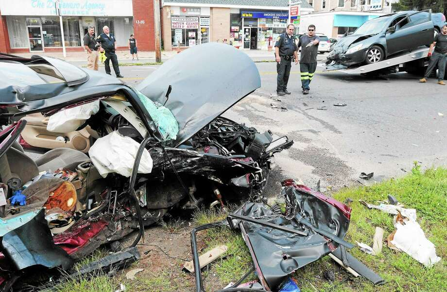 The scene of a two-car accident on Dixwell Avenue in Hamden Thursday. Photo: (Mara Lavitt — New Haven Register)