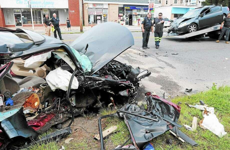 The scene of a two-car accident on Dixwell Avenue in Hamden Thursday. Photo: (Mara Lavitt — New Haven Register)