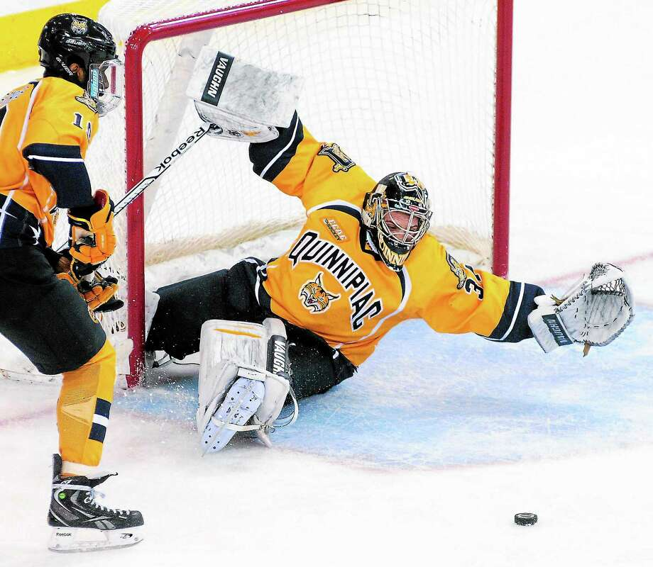 Quinnipiac goalie Michael Garteig blocks a shot from Yale during Saturday's game in Hamden. Photo: Arnold Gold — Register