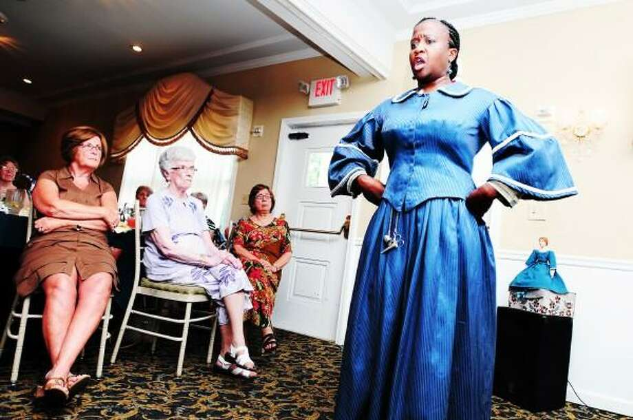 Tammy Denease (right) performs as former slave Elizabeth Keckly for the Derby Historical Society's Twenty-Third Annual Silver Tea at Molto Bene Italian American Kitchen in Ansonia on 7/8/2013. Arnold Gold - Register