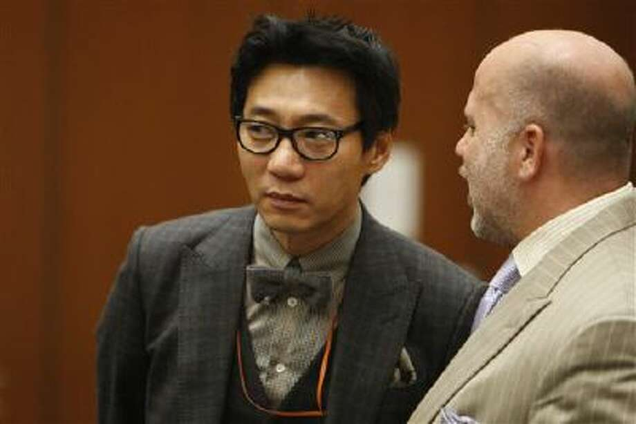 Young Lee, left, with his attorney Philip Kent Cohen during his Jan. 30, 2012, arraignment. Photo: AP / POOL Los Angeles Times