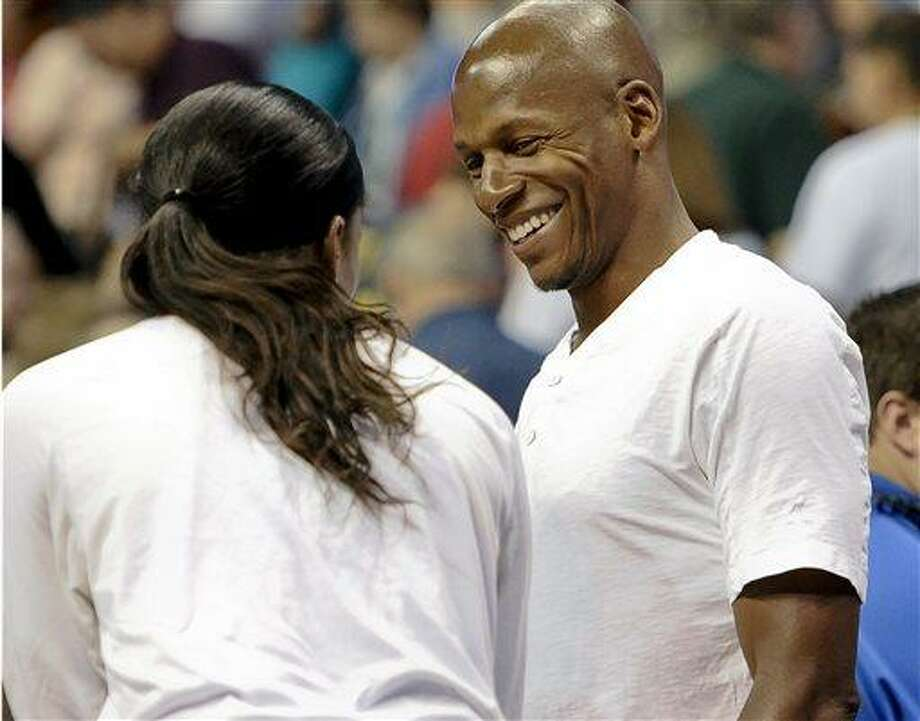 Chicago Sky's Swin Cash, left, talks with Miami Heat and fellow UConn alumni Ray Allen at the end of a WNBA basketball game in Uncasville, Conn., Friday, July 12, 2013. Chicago won 83-70. (AP Photo/Jessica Hill) Photo: AP / FR125654 AP