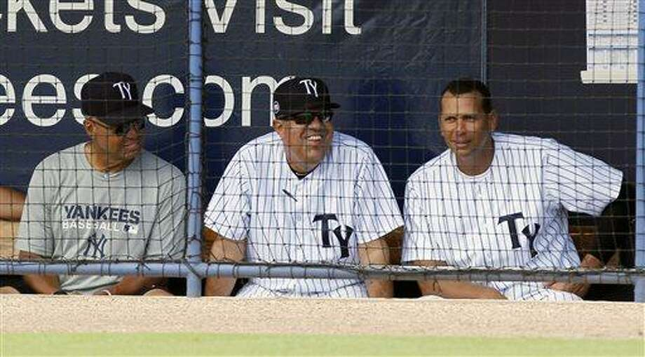 New York Yankees Alex Rodriquez, right,  sits on the bench with Reggie Jackson, left and Tampa Yankees manager Luis Sojo, during a Tampa Yankees minor league baseball game against the Dunedin Blue Jays in Tampa, Fla., Wednesday, July 10, 2013. (AP Photo/Scott Iskowitz) Photo: AP / FRE170674 AP