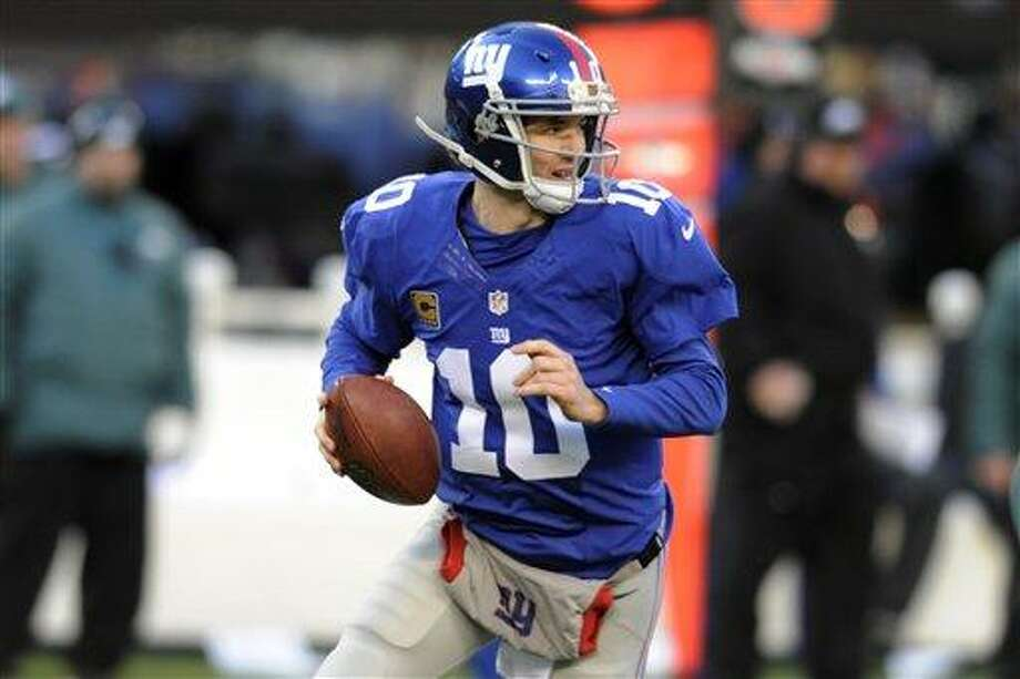 New York Giants' Eli Manning looks to pass during the first half of an NFL football game against the Philadelphia Eagles Sunday, Dec. 30, 2012 in East Rutherford, N.J. (AP Photo/Bill Kostroun) Photo: ASSOCIATED PRESS / AP2012