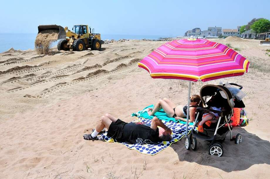 New sand is spread at East Haven Town Beach on 5/21/2013.  At right are Gerald Lindy of Hamden with his daughter, Deborah Selearis, and her son, Alexios, 2.Photo by Arnold Gold/New Haven Register   AG0499B