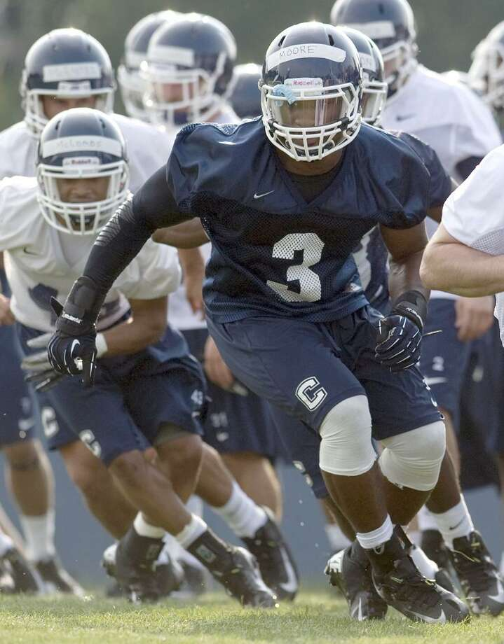 Connecticut linebacker Sio Moore (3) runs a drill the first NCAA fall football practice in Storrs, Conn., Friday, Aug. 3, 2012. (AP Photo/Jessica Hill) Photo: AP / A2012