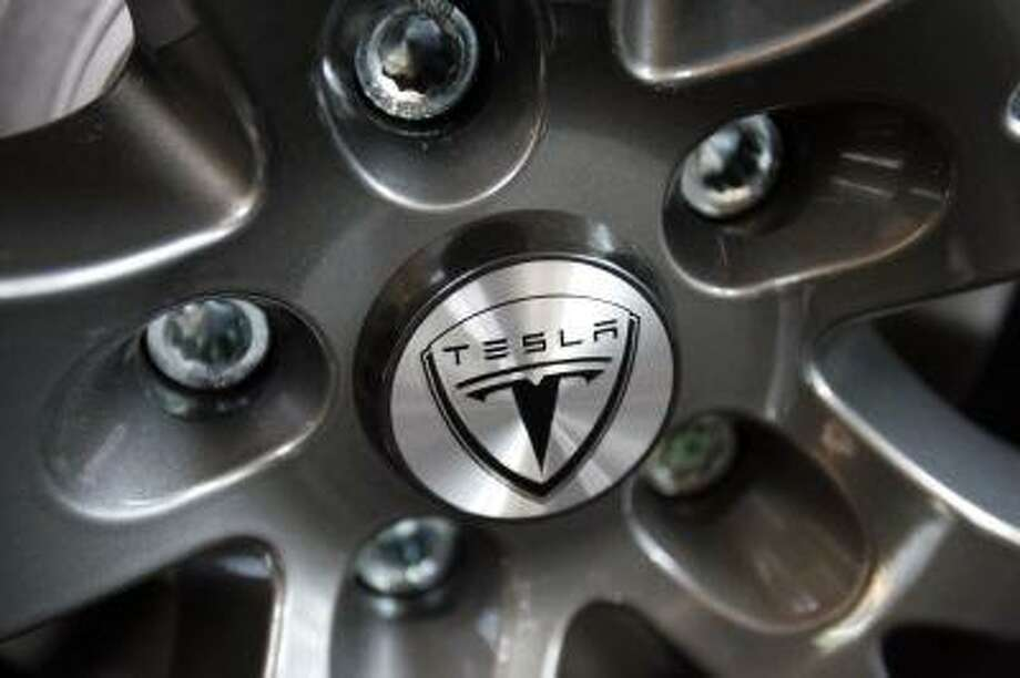 In this photo made May 29, 2009, the detail of a hubcap on Tesla electric sports car in Menlo Park, Calif. is shown. The Energy Department on Tuesday, June 23, 2009 said it would lend $5.9 billion to Ford Motor Co. and provide about $2.1 billion in loans to Nissan Motor Co. and Tesla Motors Inc., making the three automakers the first beneficiaries of a $25 billion fund to develop fuel-efficient vehicles. (AP Photo/Paul Sakuma) Photo: AP / AP