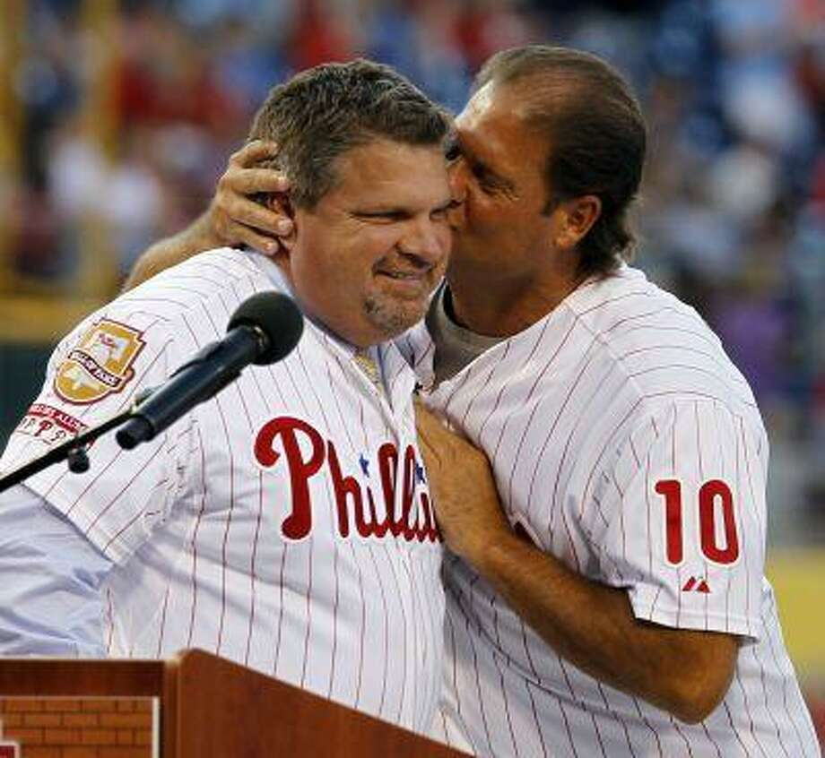 Philadelphia Phillies' John Kruk, left, is kissed by teammate Darren Daulton during a ceremony to enshrine Kruk in the Phillies Wall of Fame before a baseball game with the Washington Nationals, Friday, Aug. 12, 2011, in Philadelphia. Photo: ASSOCIATED PRESS / AP2011
