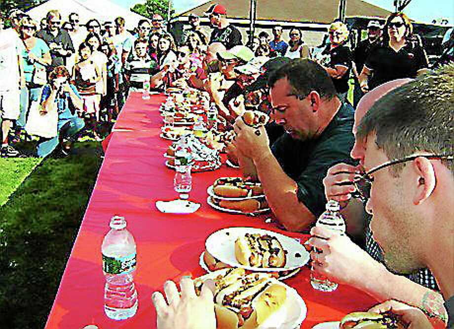 Competitors at Blackie's Hot Dog Eating Contest last year. Photo: CONTRIBUTED