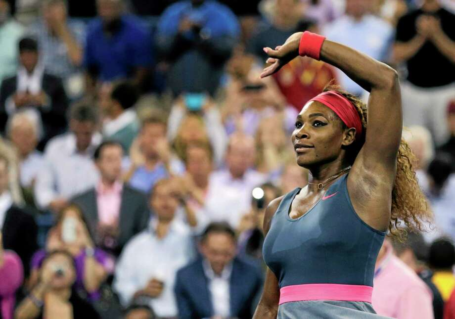 Serena Williams waves to the crowd after defeating Carla Suarez Navarro 6-0, 6-0 in a women's quarterfinal at the U.S. Open. Photo: Charles Krupa — The Associated Press   / AP
