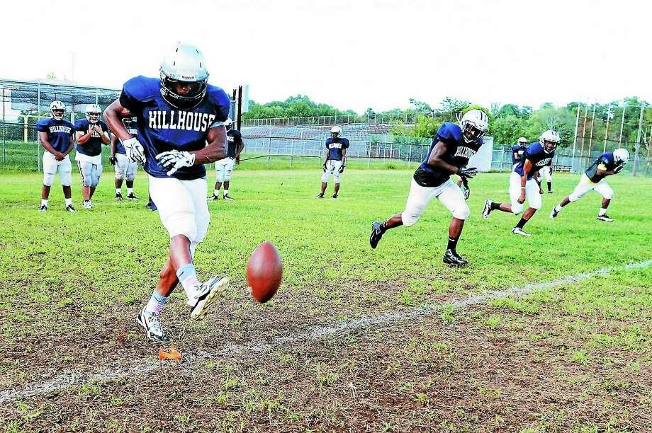 Hillhouse High School running back and kicker Harold Cooper kicks off during practice. Photo: Peter Hvizdak — Register   / ©Peter Hvizdak /  New Haven Register