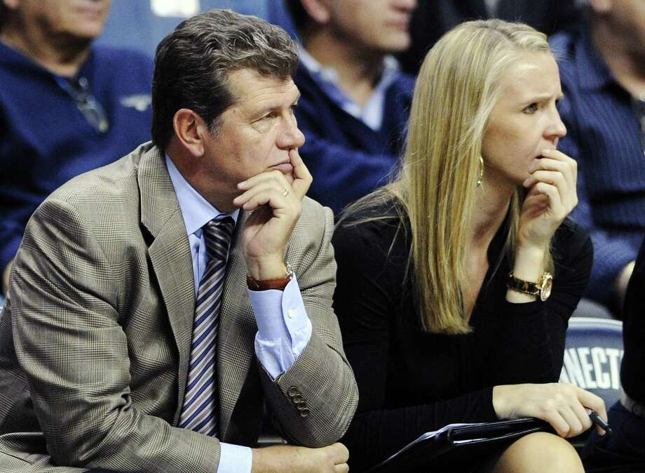 Connecticut head coach Geno Auriemma, left, and assistant coach Shea Ralph watch their team during the second half of Connecticut's 103-39 victory over Charleston in an NCAA college basketball game in Storrs, Conn., Sunday, Nov. 11, 2012. (AP Photo/Fred Beckham) Photo: ASSOCIATED PRESS / AP2012