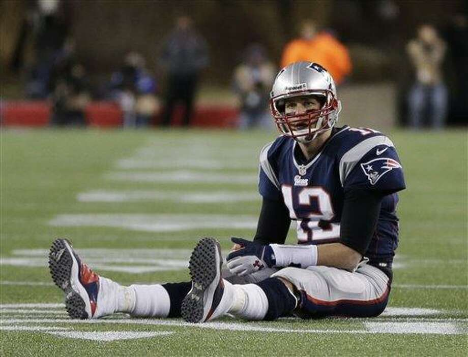 New England Patriots quarterback Tom Brady  sits on the field after getting hit during the second half of the NFL football AFC Championship football game against the Baltimore Ravens in Foxborough, Mass., Sunday, Jan. 20, 2013. (AP Photo/Steven Senne) Photo: ASSOCIATED PRESS / AP2013