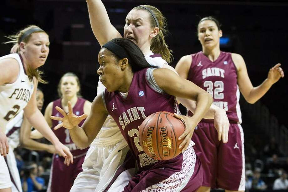 Saint Joseph's Ashley Prim (25) drives to the basket during the first half of their NCAA women's college basketball championship game against Fordham at the Atlantic 10 Conference tournament on Saturday, March 16, 2013, in New York. (AP Photo/John Minchillo) Photo: AP / FR170537 AP