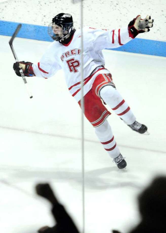 Michael Ventricelli of Fairfield Prep celebrates after scoring a goal to tie the score 2-2 in the second period against Notre Dame-West Haven in the CIAC State Hockey Championship at Ingalls Rink in New Haven on 3/19/2013.Photo by Arnold Gold/New Haven Register