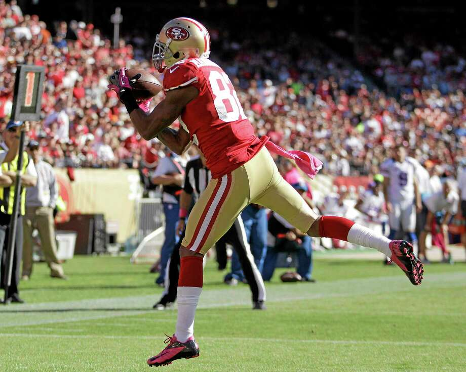 In this Oct. 7, 2012 file photo, 49ers wide receiver Mario Manningham catches a touchdown pass against the Buffalo Bills in San Francisco. The San Francisco 49ers have reloaded coming out of their bye week. All-Pro linebacker Aldon Smith is returning after a five-game absence to receive treatment for substance abuse. Wide receiver Mario Manningham is healthy again going on 11 months after a devastating, season-ending knee injury. Photo: Ben Margot — The Associated Press   / AP