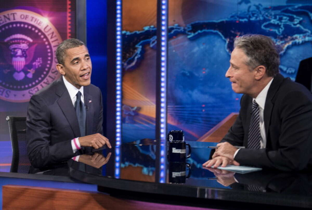 """US President Barack Obama and host Jon Stewart speak during a break in the live taping of Comedy Central?s """"Daily Show with Jon Stewart"""" on October 18, 2012 in New York. This is the second appearence on the satirical show by President Obama. AFP PHOTO/Brendan SMIALOWSKI (Photo credit should read BRENDAN SMIALOWSKI/AFP/Getty Images)"""