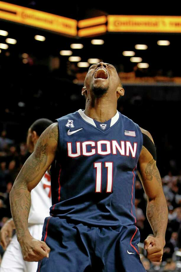 UConn's Ryan Boatright reacts after scoring against Maryland during the first half of the 18th-ranked Huskies' 78-77 win on Friday night in New York. Photo: Jason DeCrow — The Associated Press   / FR103966 AP