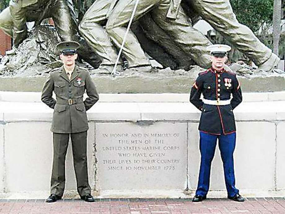Photo Courtesy LASHER FAMILY  Lance Cpl. Jeremy Lasher, right, and his brother, Cpl. Ryan Lasher stand in front of the United State Marine Corps monument in Parris Island after Jeremy Lasher's 2007 training graduation.