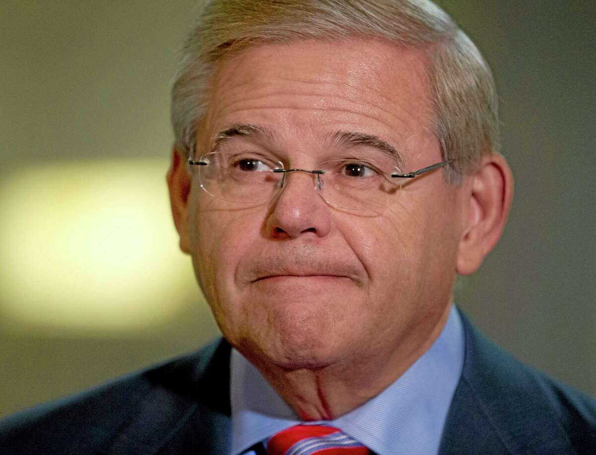 Senate Foreign Relation Committee Chairman Sen. Robert Menendez, D-N.J., pauses as he talks to reporters on Capitol Hill in Washington, Wednesday, Sept. 4, 2013, before a closed-door committee meeting on the authorization of the use of force in Syria.