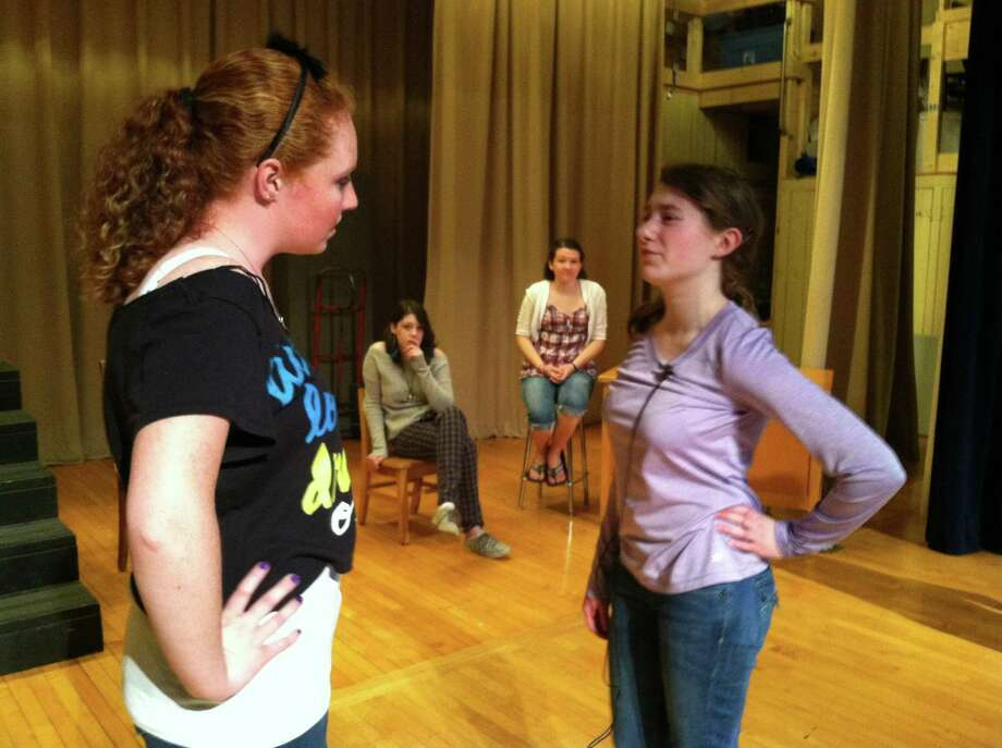 "Nick Will/Oneida Daily Dispatch Catherine Reynolds, played by Krista Scalzo, argues with Clarrissa De Ville, played by Katie Box, in front of classmates Makayla Rogers and Samantha Fairchild for Madison's production of ""I Am A Star"" on Monday, May 20, 2013."