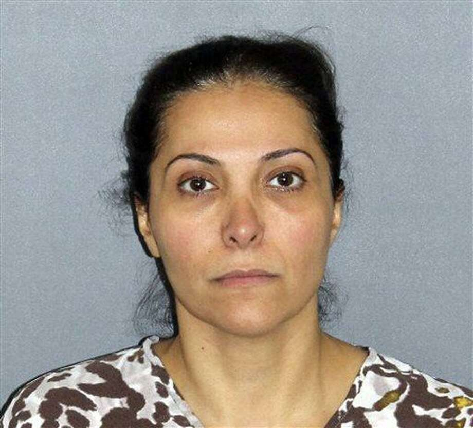 FILE - This file photo provided by the Irvine Police Department shows Meshael Alayban, who was arrested July 9, 2013 in Irvine, Calif., for allegedly holding a domestic servant against her will. Alayban, who prosecutors said is one of the wives of Saudi Prince Abdulrahman bin Nasser bin Abdulaziz al Saud, was expected to appear in an Orange County court for arraignment Thursday, July 11, 2013. (AP Photo/Irvine Police Department, File) Photo: AP / Irvine Police Department