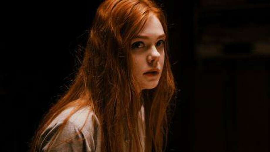 "This publicity photo released by A24 Films shows Elle Fanning as Ginger in a scene from the film, ""Ginger and Rosa,"" directed by Sally Potter. (AP Photo/A24 Film, Nicola Dove) Photo: AP / A24 Films"