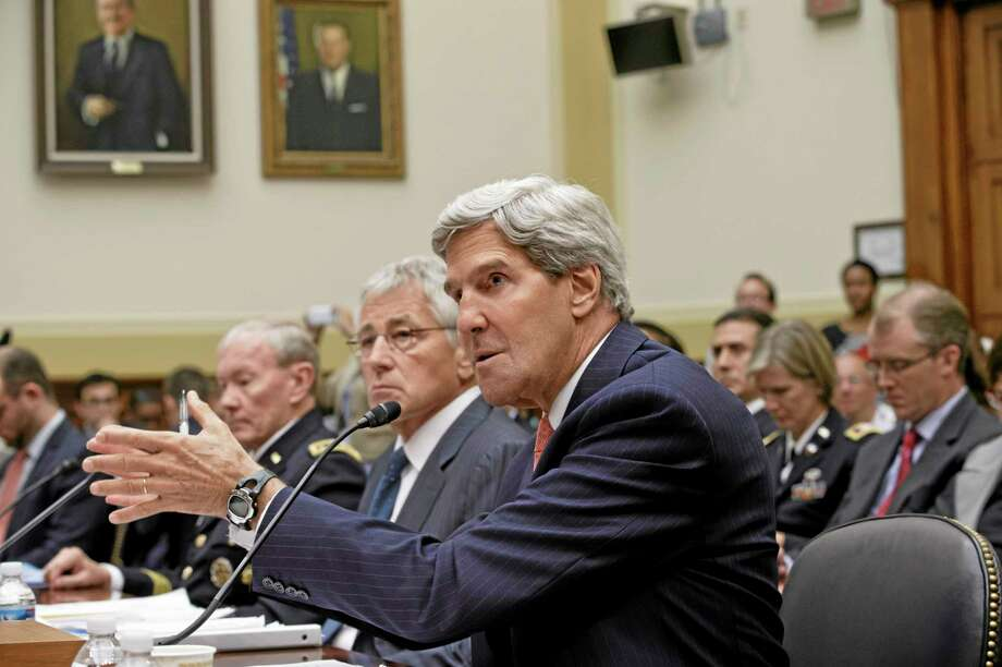 Secretary of State John Kerry, right, accompanied by Defense Secretary Chuck Hagel, center, and Joint Chiefs Chairman Gen. Martin Dempsey, left, testifies on Capitol Hill in Washington, Wednesday, Sept. 4, 2013, before the House Foreign Affairs Committee hearing to advance President Barack Obama's request for congressional authorization for military intervention in Syria, a response to last month's alleged sarin gas attack in the Syrian civil war. (AP Photo/J. Scott Applewhite) Photo: AP / AP
