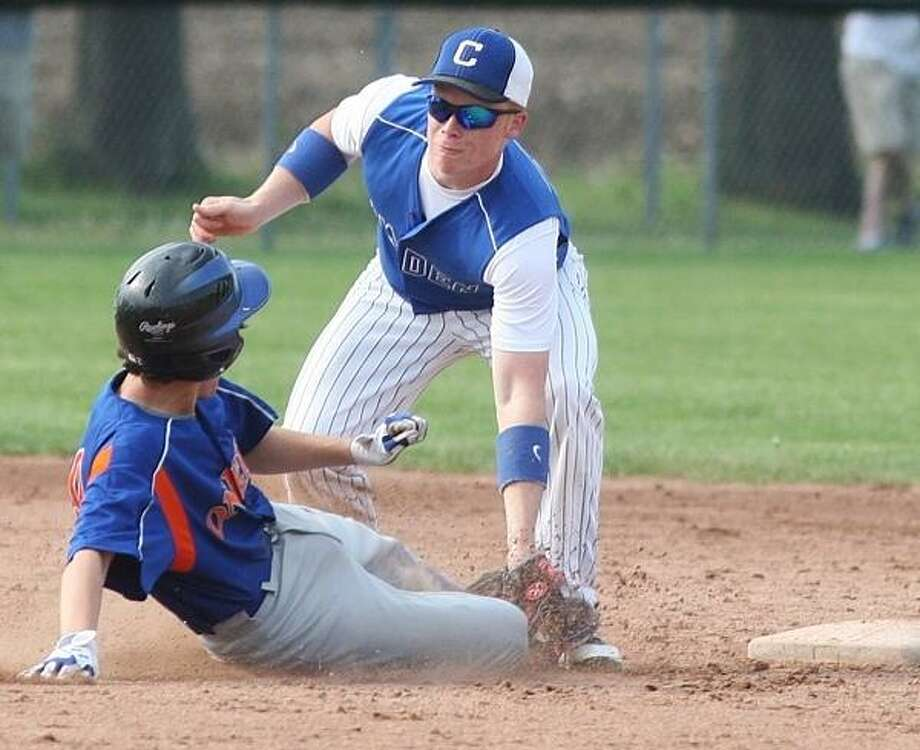 PHOTO BY JOHN HAEGER @ ONEIDAPHOTO ON TWITTER/ONEIDA DAILY DISPATCH Oneida's Michael Lerch (9) is tagged out by Camden's James Mitchell (21) as he tries to steal second in the top of the second inning of their game in Camden on Tuesday, May 21, 2013.