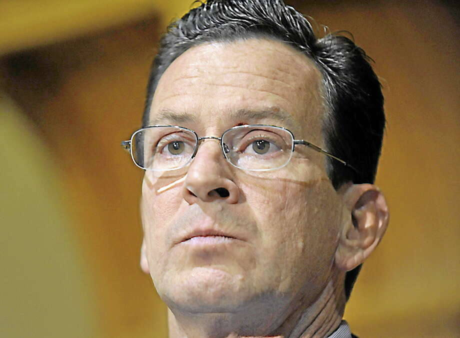 FILE - In this Nov. 8, 2010 file photo, Dan Malloy, who won the Connecticut governor's race, speaks to the media at the Capitol in Hartford, Conn. Twenty-six states elected new governors last month _ 17 Republicans, 8 Democrats and one independent _ and now they are going to have to reconcile their principles and campaign promises with some harsh fiscal realities. Malloy, the former Stamford mayor, said he will have to raise taxes and cut services to close a projected $3.5 billion shortfall, one of the largest of any state as a percentage of its overall budget. (AP Photo/Jessica Hill, File) Photo: AP / AP2010