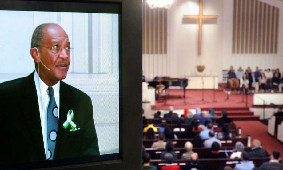 Newtown Congregational Church held a Service of Hope and Healing.   Rev.James Forbes (retired Riverside Church, NYC) of the Healing of the Nations Foundation, in TV monitor left, was the featured speaker.  Mara Lavitt/New Haven Register1/20/13