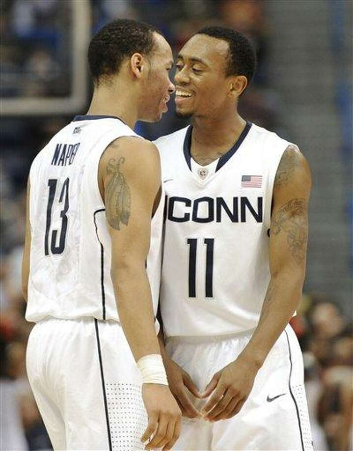 UConn's Shabazz Napier, left, and Ryan Boatright. (AP File Photo/Jessica Hill) Photo: AP / AP2011